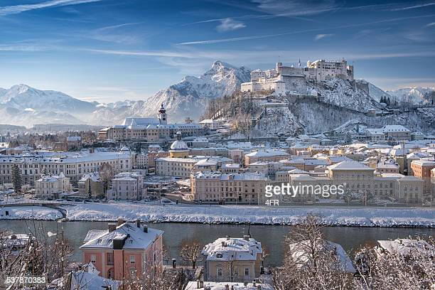 salzburg with hohensalzburg covered in snow, austrian alps - salzburger land stock pictures, royalty-free photos & images
