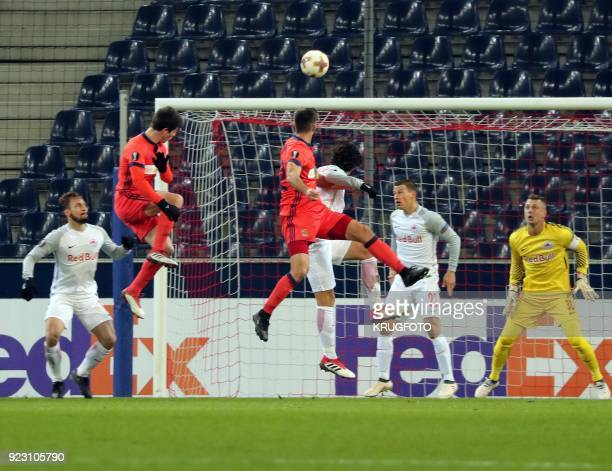 Salzburg's Alexander Walke and Andre Silva Ramalho heads the ball during the UEFA Europa League second leg round of 32 football match between Real...
