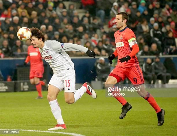 Salzburg's Andre Silva Ramalho and Real Sociedad's Imanol Agirretxe Arruti vie with the ball during the UEFA Europa League second leg round of 32...