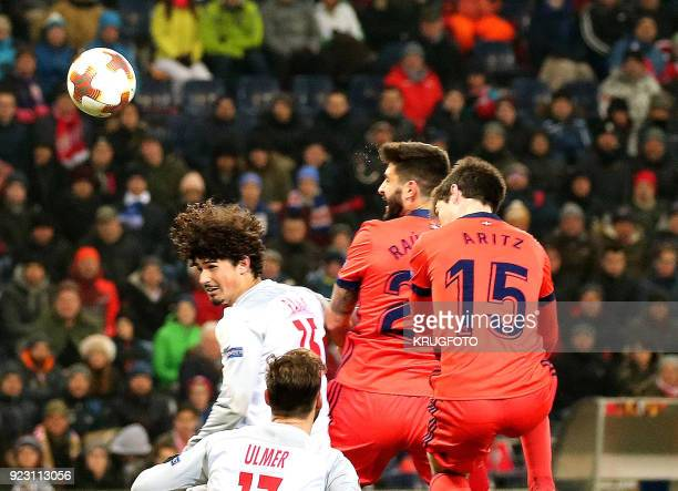 Salzburg's Andre Silva Ramalho and Real Sociedad's Raul Rodriguez Navas and Aritz Elustondo Irribarria vie with the ball during the UEFA Europa...