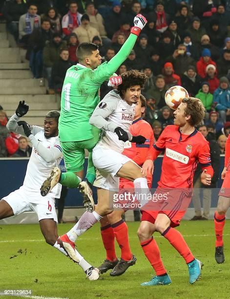 Salzburg's Andre Silva Ramalho vies with Real Sociedad's goalkeeper Geronimo Rulli and Real Sociedad's Juanmi Juan Miguel Jimenez Lopez during the...