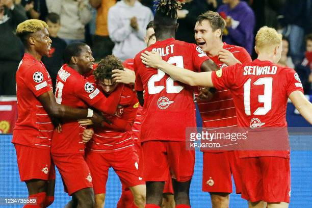 Salzburg's Brenden Russell Aaronson celebrates with teammates after scoring during their UEFA Champions League third preliminary round football match...
