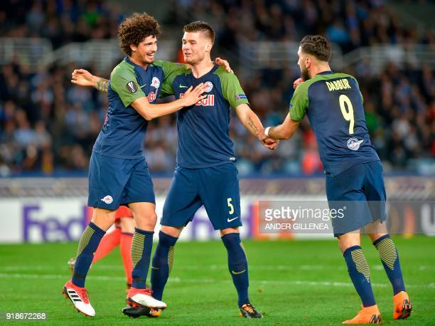 FC Salzburg's Croatian defender Duje CaletaCar is congratulated by teammates Brazilian defender Andre Ramalho and Israeli forward Munas Dabbur during...