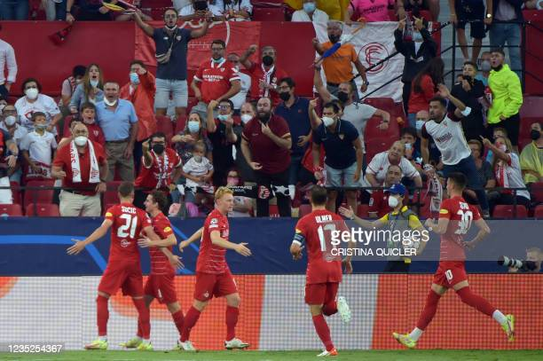 Salzburg's Croatian midfielder Luka Susic celebrates after scoring the opening goal during the UEFA Champions League first round group G football...
