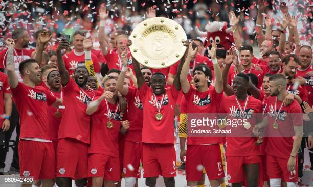 Salzburg's Diadie Samassekou celebrates with the trophy for winning the Austrian Soccer Championship after the tipico Bundesliga match between RB...