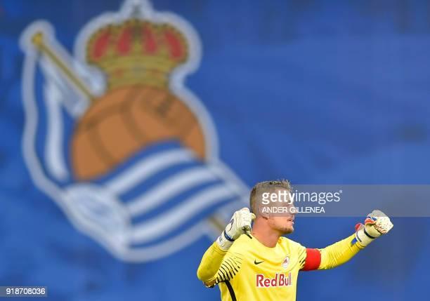 FC Salzburg's German goalkeeper Alexander Walke celebrates his team's second goal during the UEFA Europa League first leg round of 32 football match...