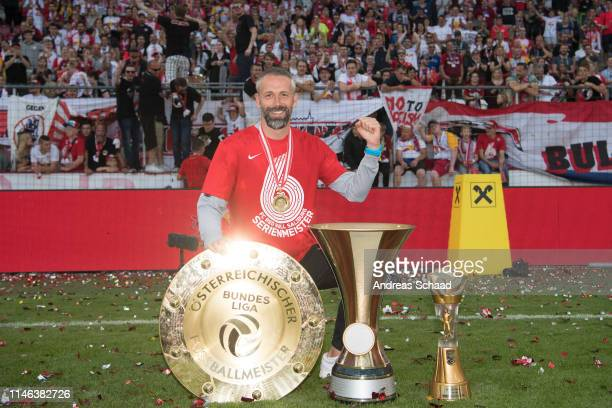 Salzburg's head coach Marco Rose celebrates with the trophy for winning the Austrian Soccer Championship after the tipico Bundesliga match between RB...