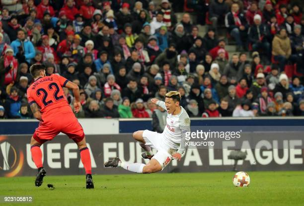 Salzburg's Hee Chan Hwang and Real Sociedad's Raul Rodriguez Navas vie with the ball during the UEFA Europa League second leg round of 32 football...