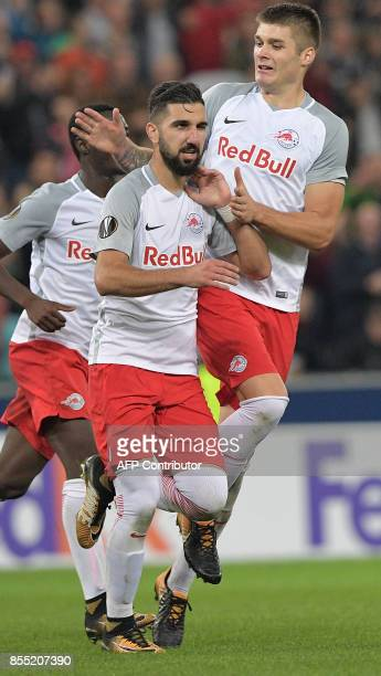 Salzburg's Israeli forward Munas Dabbur and Croatian defender Duje CaletaCar celebrate their first goal during the UEFA Europa League group I...