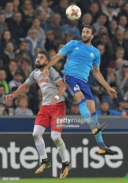 Salzburg's Israeli forward Munas Dabbur and Marseille's French defender Adil Rami vie for the ball during the UEFA Europa League group I football...