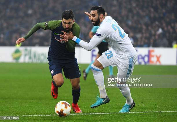 Salzburg's Israeli forward Munas Dabbur vies with Marseille's French defender Adil Rami during the UEFA Europa League Group I football match between...