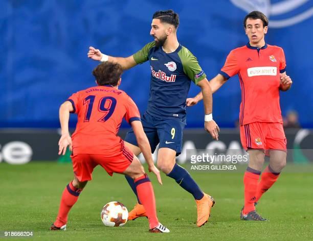 FC Salzburg's Israeli forward Munas Dabbur vies with Real Sociedad's Spanish defender Alvaro Odriozola during the UEFA Europa League first leg round...