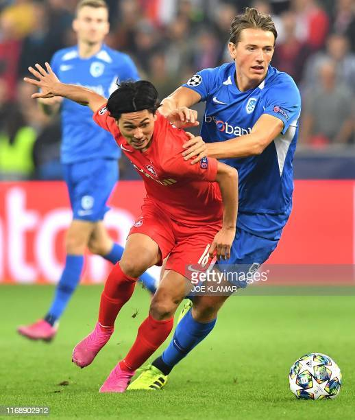 Salzburg's Japanese forward Takumi Minamino and RC Genk's Norwegian midfielder Sander Berge during the UEFA Champions League Group E football match...
