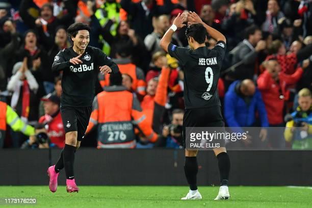 Salzburg's Japanese forward Takumi Minamino celebrates with Salzburg's South Korean midfielder Hwang HeeChan after scoring their second goal during...
