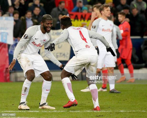 Salzburg's Jerome Junior Onguene and Salzburg's Amadou Haidara celebrate after winning the UEFA Europa League second leg round of 32 football match...