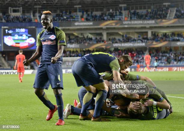 FC Salzburg's Malian midfielder Amadou Haidara and teammates celebrate their second goal during the UEFA Europa League first leg round of 32 football...