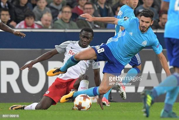 Salzburg's Malian midfielder Diadie Samassekou and Olympique de Marseille's French midfielder Morgan Sanson vie for a ball during the UEFA Europa...