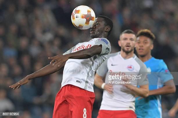 Salzburg's Malian midfielder Diadie Samassekou heads a ball during the UEFA Europa League group I football match between FC Salzburg and Olympique de...