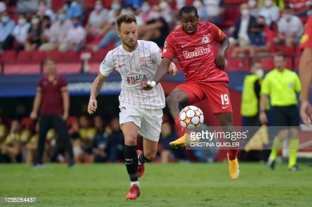 Salzburg's Malian midfielder Mohamed Camara vies with Sevilla's Croatian midfielder Ivan Rakitic during the UEFA Champions League first round group G...