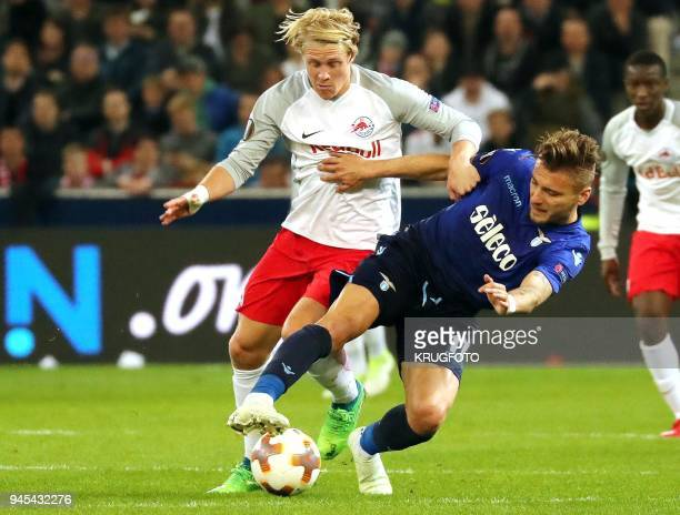 Salzburg's midfielder from Austria Xaver Schlager and Ciro Lazio's midfielder Ciro Immobile vie for the ball during the UEFA Europa League quarter...