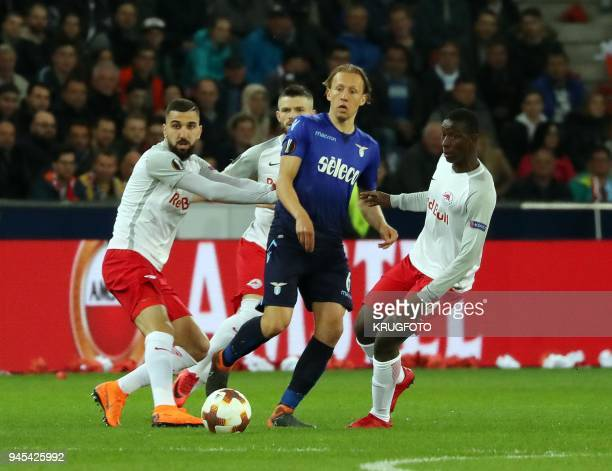 Salzburg's midfielder from Mali Amadou Haidara and Lazio's defender from Brazil Lucas Leiva vie for the ball during the UEFA Europa League quarter...