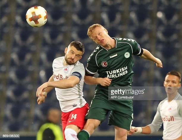 Salzburg's midfielder from Norway Valon Berisha and Konyaspor's midfielder from Denmark Jens Jonsson vie for the ball during the UEFA Europa League...
