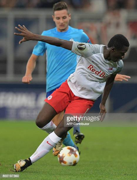 Salzburg's midfielder Malian Diadie Samassekou and Olympique de Marseille's French midfielder Florian Thauvin vie for the ball during the UEFA Europa...