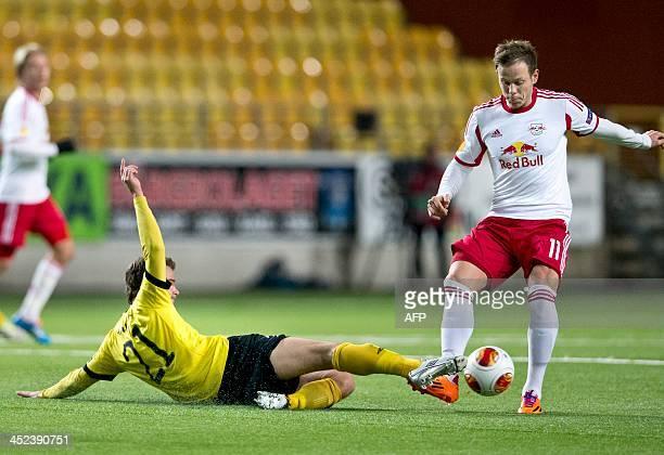 Salzburg's midfielder Marco Meilinger and Elfsborg's Norwegian midfielder Henning Hauger vie for the ball during the UEFA Europa League Group C...