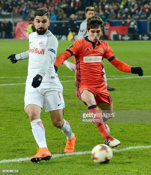 Salzburg's Munas Dabbur and Real Sociedad's Aritz Elustondo Irribarria vie with the ball during the UEFA Europa League second leg round of 32...