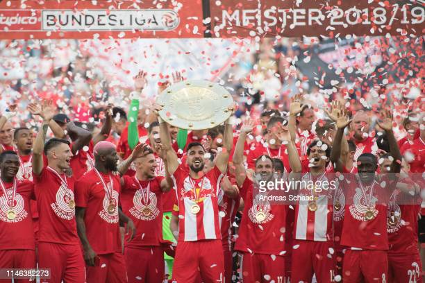 Salzburg's Munas Dabbur celebrates with the trophy for winning the Austrian Soccer Championship after the tipico Bundesliga match between RB Salzburg...