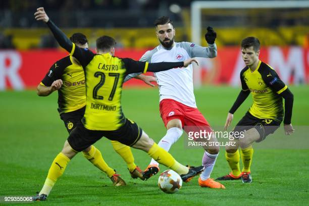Salzburg's Munas DabburDortmund's German midfielder Julian Weigl and Dortmund's German midfielder Gonzalo Castro vie for the ball during the Europa...