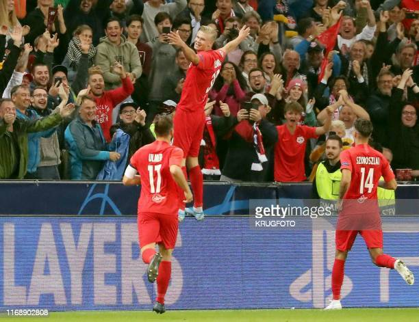 Salzburg's Norwegian forward Erling Braut Haland celebrate scoring with their fans during the UEFA Champions League Group E football match Salzburg v...