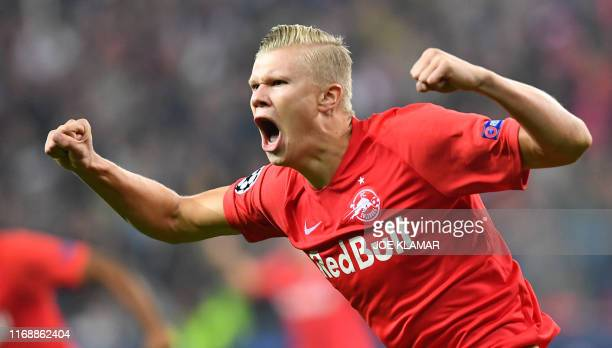 Salzburg's Norwegian forward Erling Braut Haland celebrates after scoring 10 during the UEFA Champions League Group E football match Salzburg v Genk...