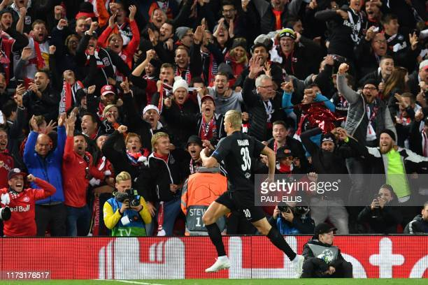 Salzburg's Norwegian forward Erling Braut Haland celebrates after scoring their third goal during the UEFA Champions league Group E football match...