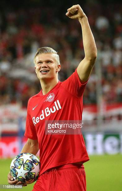 Salzburg's Norwegian forward Erling Braut Haland celebrates after the UEFA Champions League Group E football match Salzburg v Genk in Salzburg...