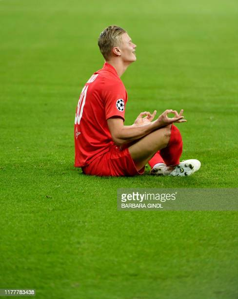 Salzburg's Norwegian forward Erling Braut Haland celebrates after scoring the 11 during the UEFA Champions League Group E football match FC Red Bull...