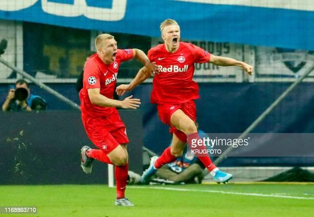 Salzburg's Norwegian forward Erling Braut Haland celebrates scoring the opening goal with Salzburg's Danish defender Rasmus Kristensen during the...