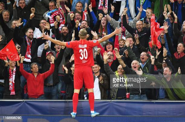 Salzburg's Norwegian forward Erling Braut Haland celebrates scoring the second goal during the UEFA Champions League Group E football match Salzburg...