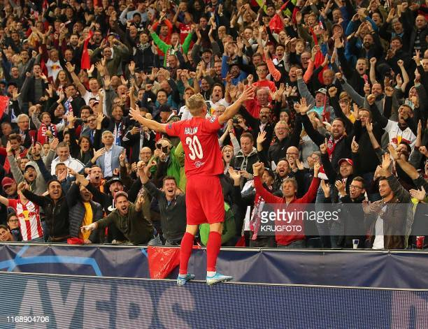 Salzburg's Norwegian forward Erling Braut Haland celebrates scoring during the UEFA Champions League Group E football match Salzburg v Genk in...