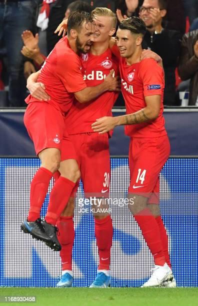 Salzburg's Norwegian forward Erling Braut Haland celebrates scoring with his teammates Salzburg's Austrian defender Andreas Ulmer and Salzburg's...