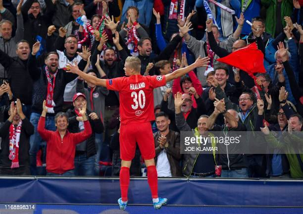 Salzburg's Norwegian forward Erling Braut Haland faces supporters as he celebrates scoring the second goal during the UEFA Champions League Group E...