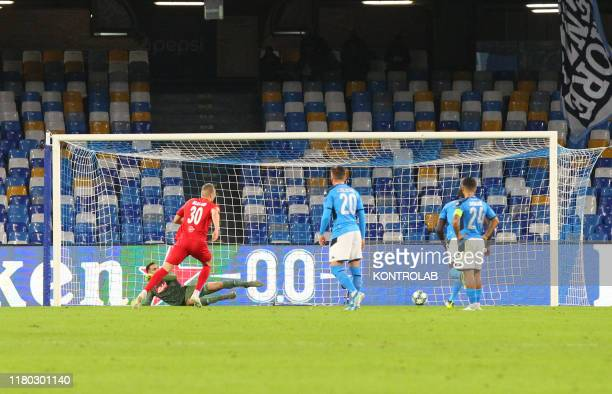 Salzburg's Norwegian forward Erling Braut Haland scores a penalty during the UEFA Champions League Group E football match SSC Napoli vs FC Red Bull...