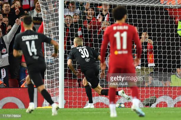 Salzburg's Norwegian forward Erling Braut Haland turns to celebrate after scoring their third goal during the UEFA Champions league Group E football...