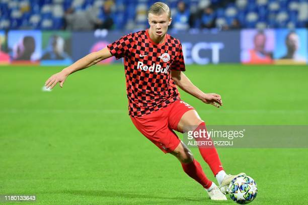 Salzburg's Norwegian forward Erling Braut Haland warms up prior to the UEFA Champions League Group E football match Napoli vs Salzburg on November 5,...