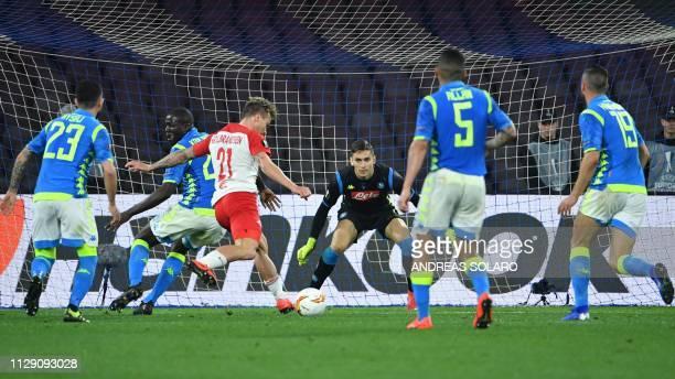 Salzburg's Norwegian midfielder Fredrik Gulbrandsen shoots on goal to challenge Napoli's Italian goalkeeper Alex Meret in the last minute during the...