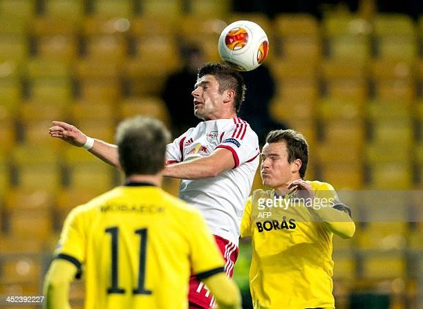 Salzburg's Norwegian midfielder Valon Berisha and Elfsborg's Norwegian midfielder Henning Hauger vie for the ball during the UEFA Europa League Group...