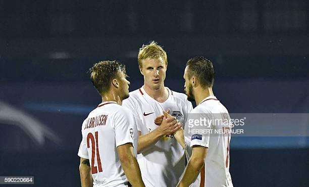 Salzburg's player Fredrik Gulbrandsen Martin Hinteregger and Andreas Ulmer stand after the UEFA Champions league first leg playoff football match...