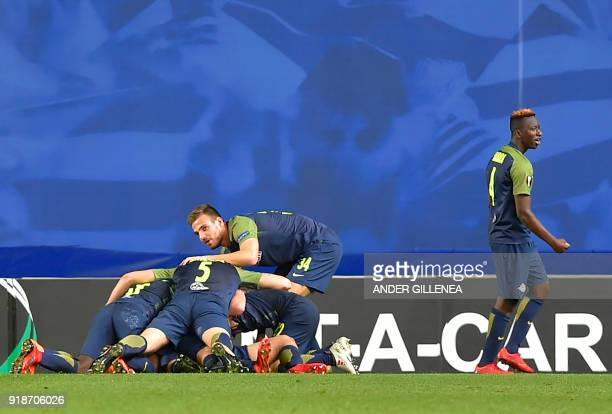 FC Salzburg's players celebrate after scoring their second goal during the UEFA Europa League first leg round of 32 football match between Real...