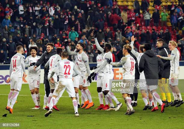 Salzburg's players celebrate after winning the UEFA Europa League second leg round of 32 football match between Real Sociedad and FC Salzburg on...