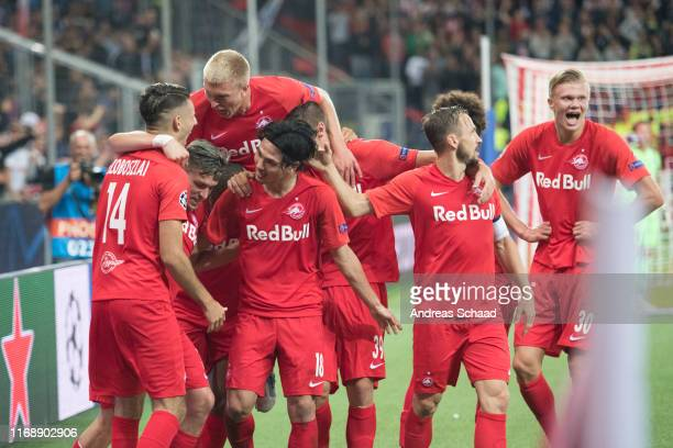 Salzburg's players Dominik Szoboszlai Zlatko Junuzovic Rasmus Kristensen Takumi Minamino Andreas Ulmer and Erling Haaland celebrate after Dominik...